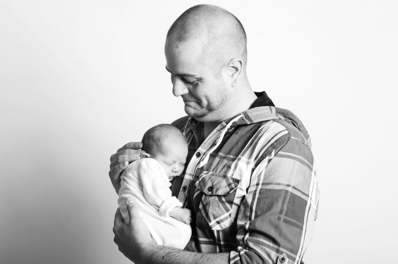 Father and baby by Sussex portrait photographer James Robertshaw