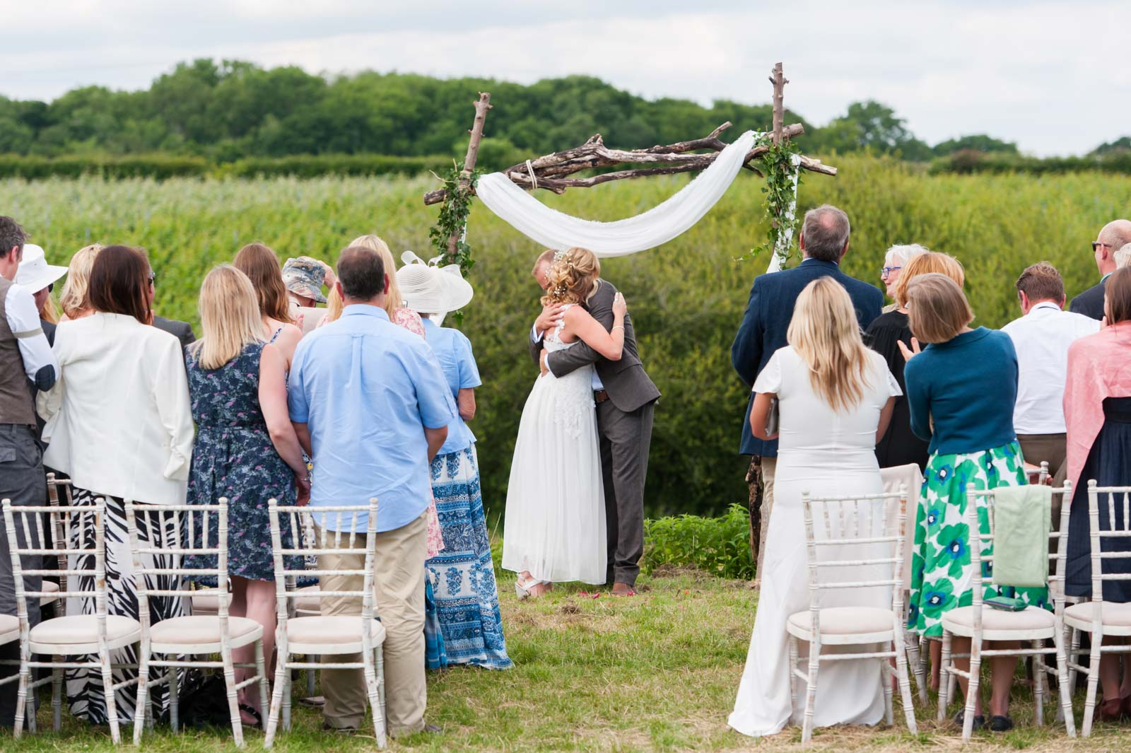 Couple embracing at outdoor wedding