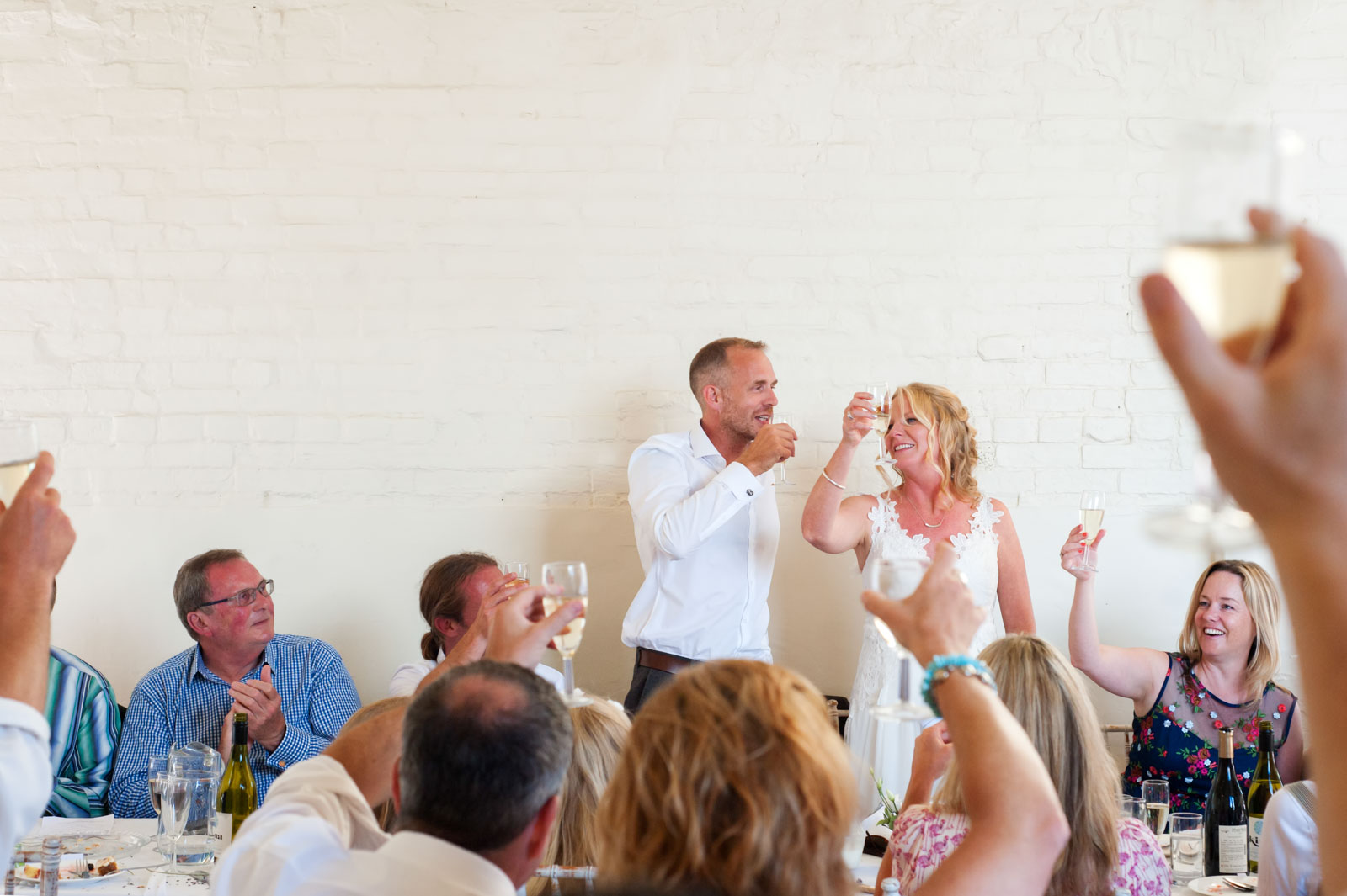 Bride and groom toasting at Court Gardens Farm wedding
