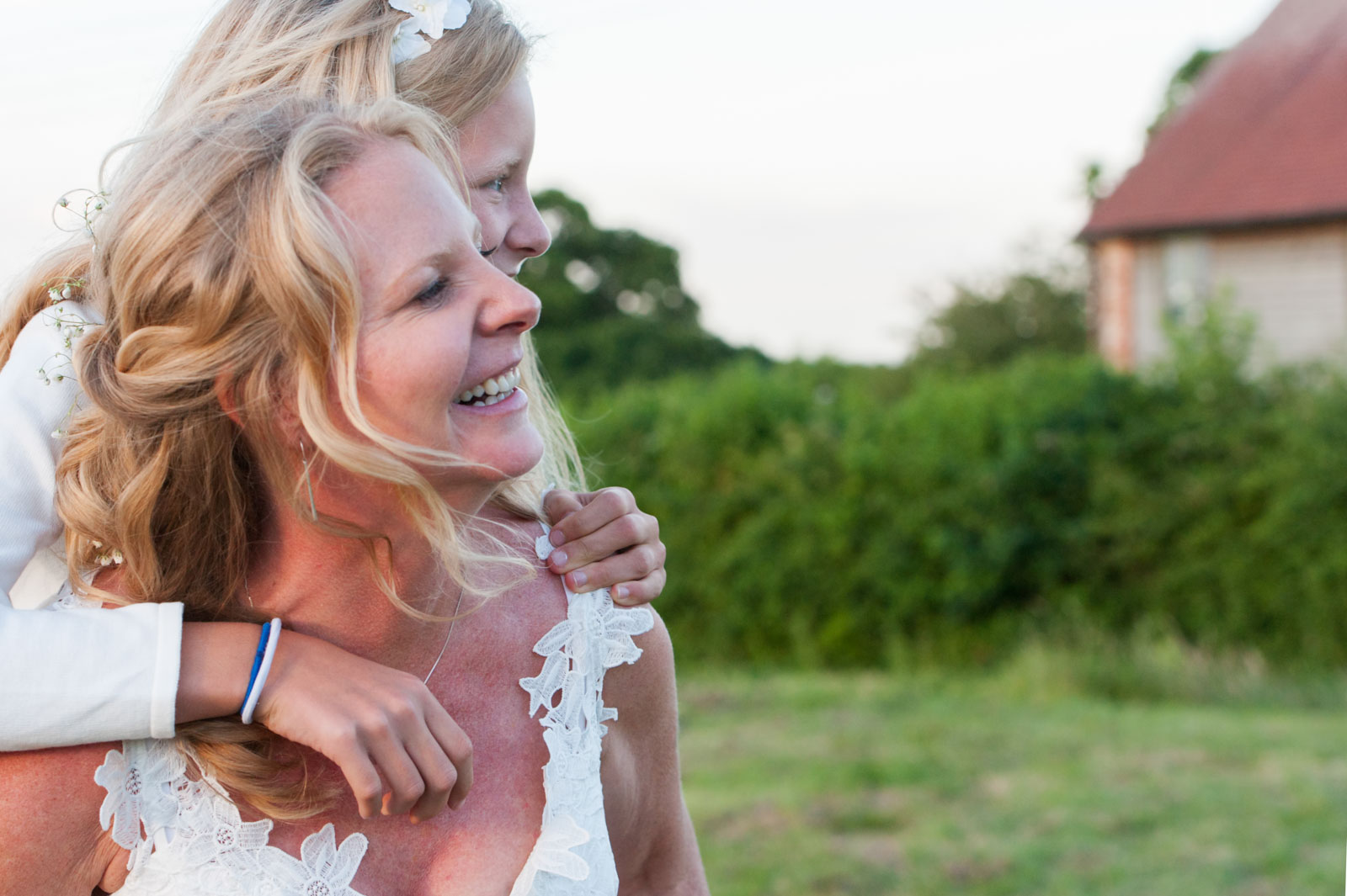 Bride and daughter smiling at Court Gardens farm wedding