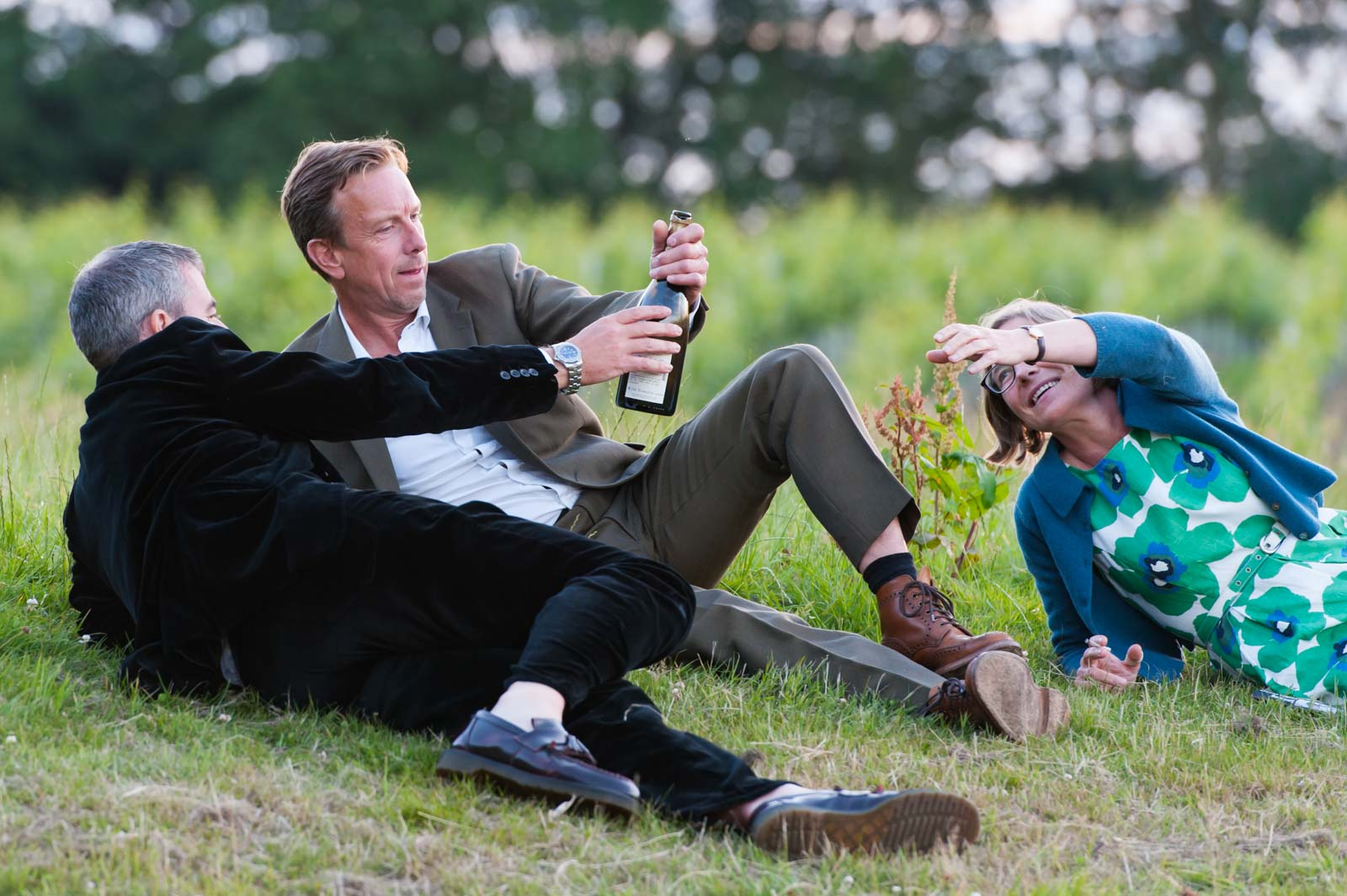 Guests relaxing in a field at Court Gardens Farm wedding