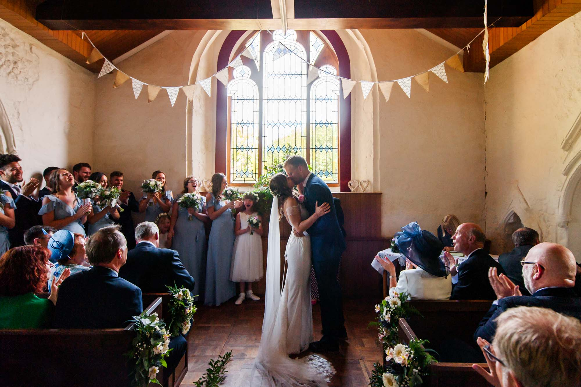 First kiss during Wedding ceremony at Otham Court wedding
