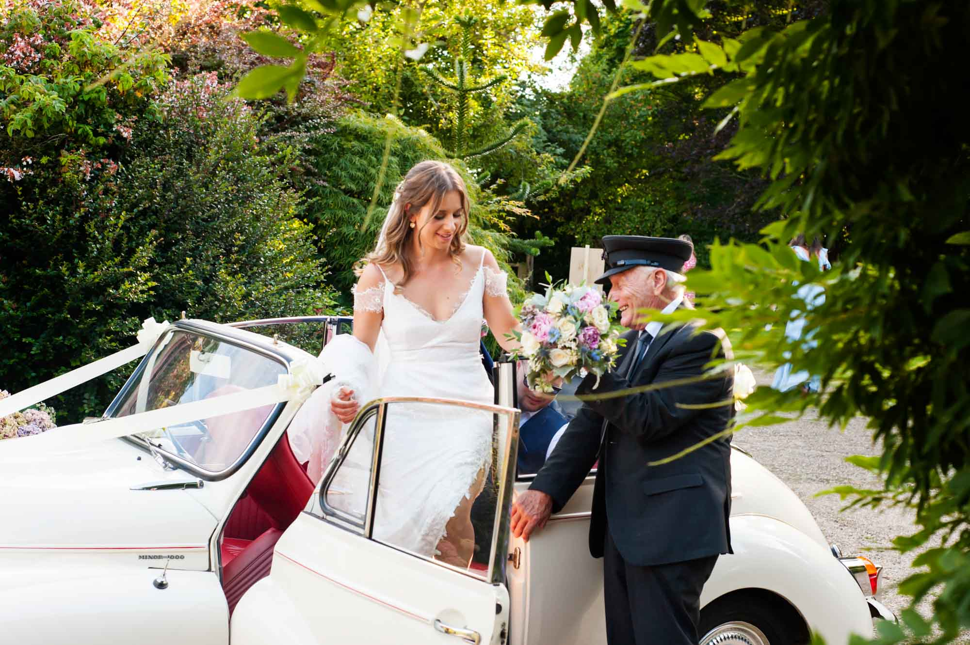 Bride stepping out of Morris Minor
