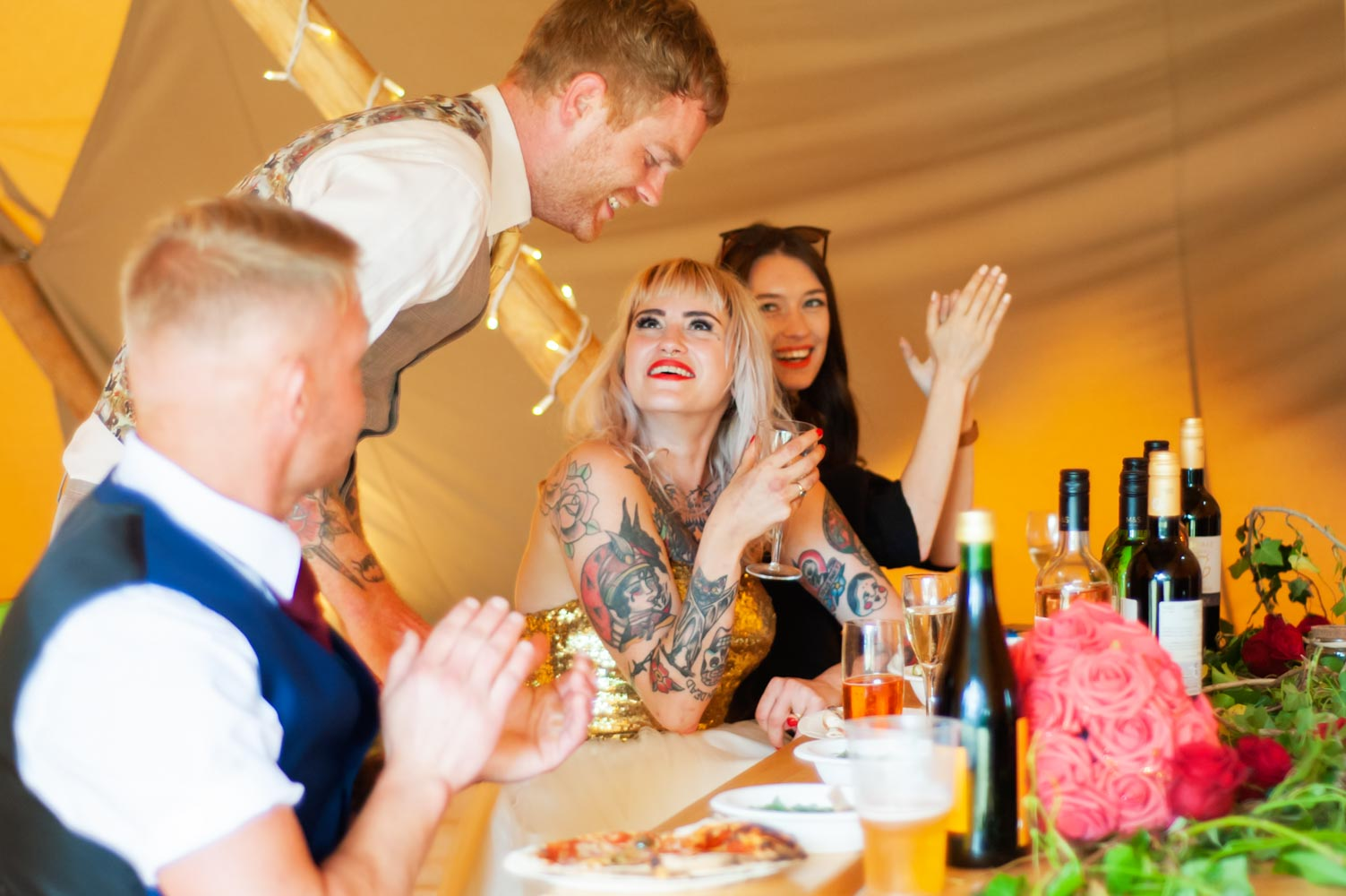 Wife looking up at groom by alternative sussex wedding photographer James Robertshaw