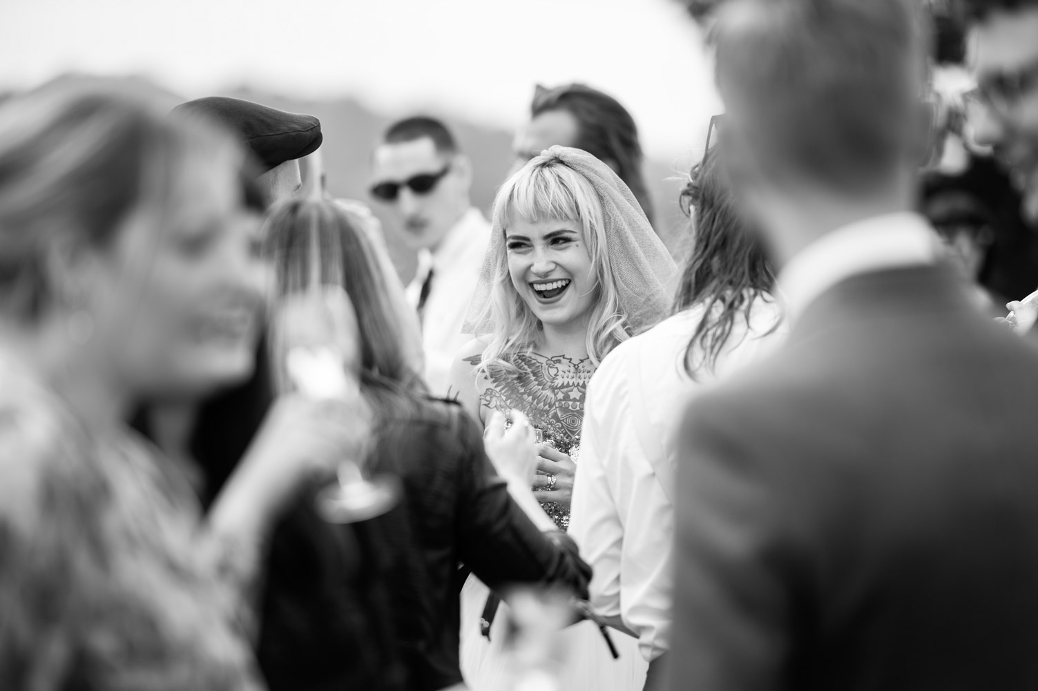 Bride laughing with friends by alternative sussex wedding photographer James Robertshaw