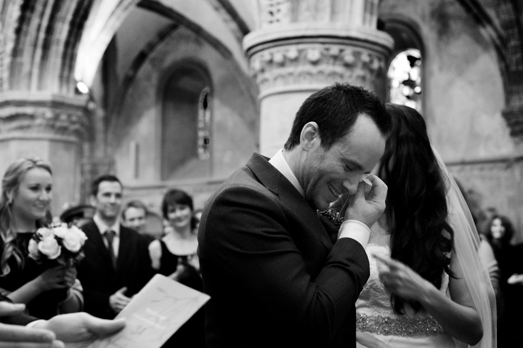 Groom wiping tear by Sussex wedding photographer James Robertshaw