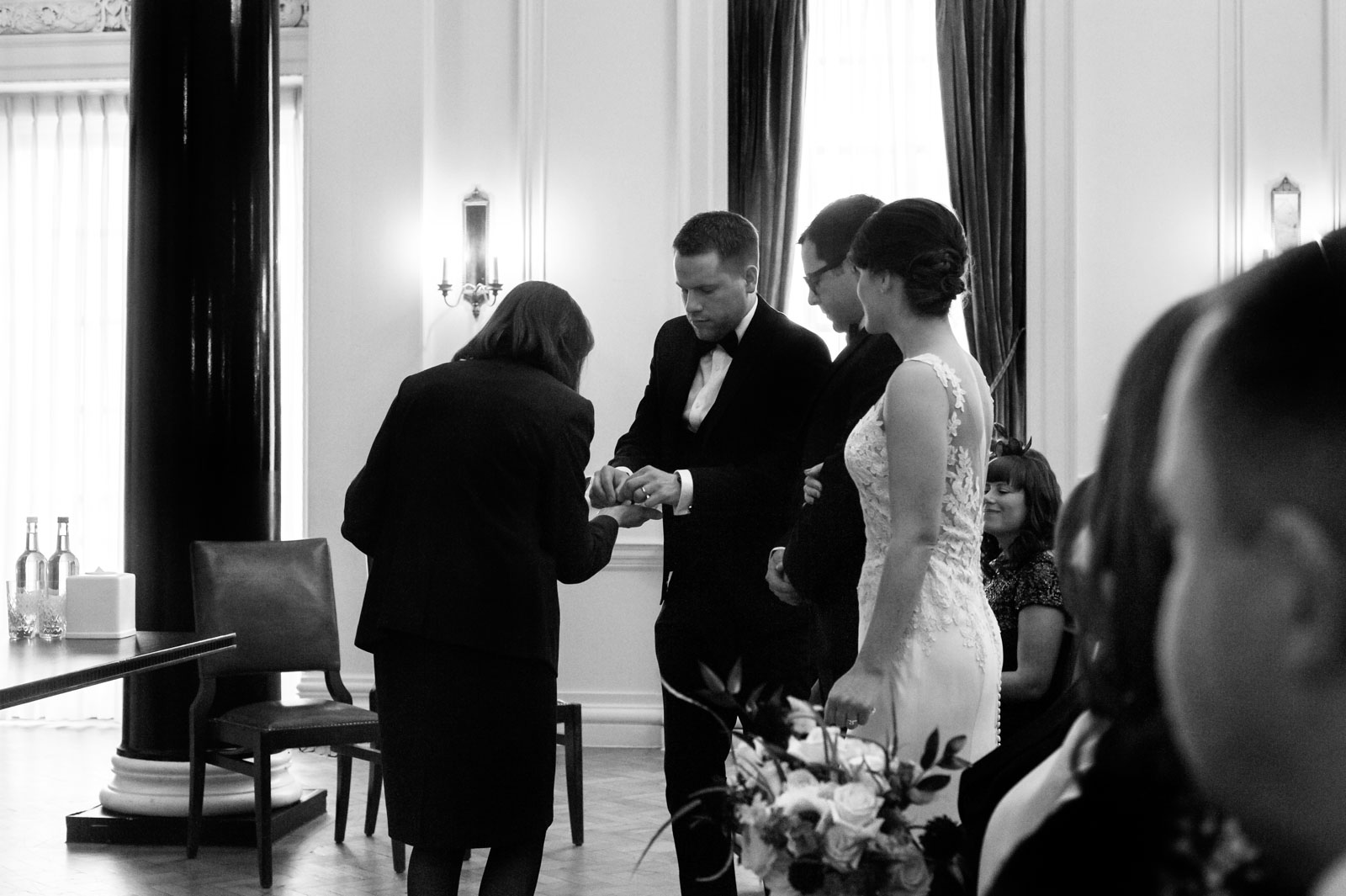 Best man taking rings during ceremony