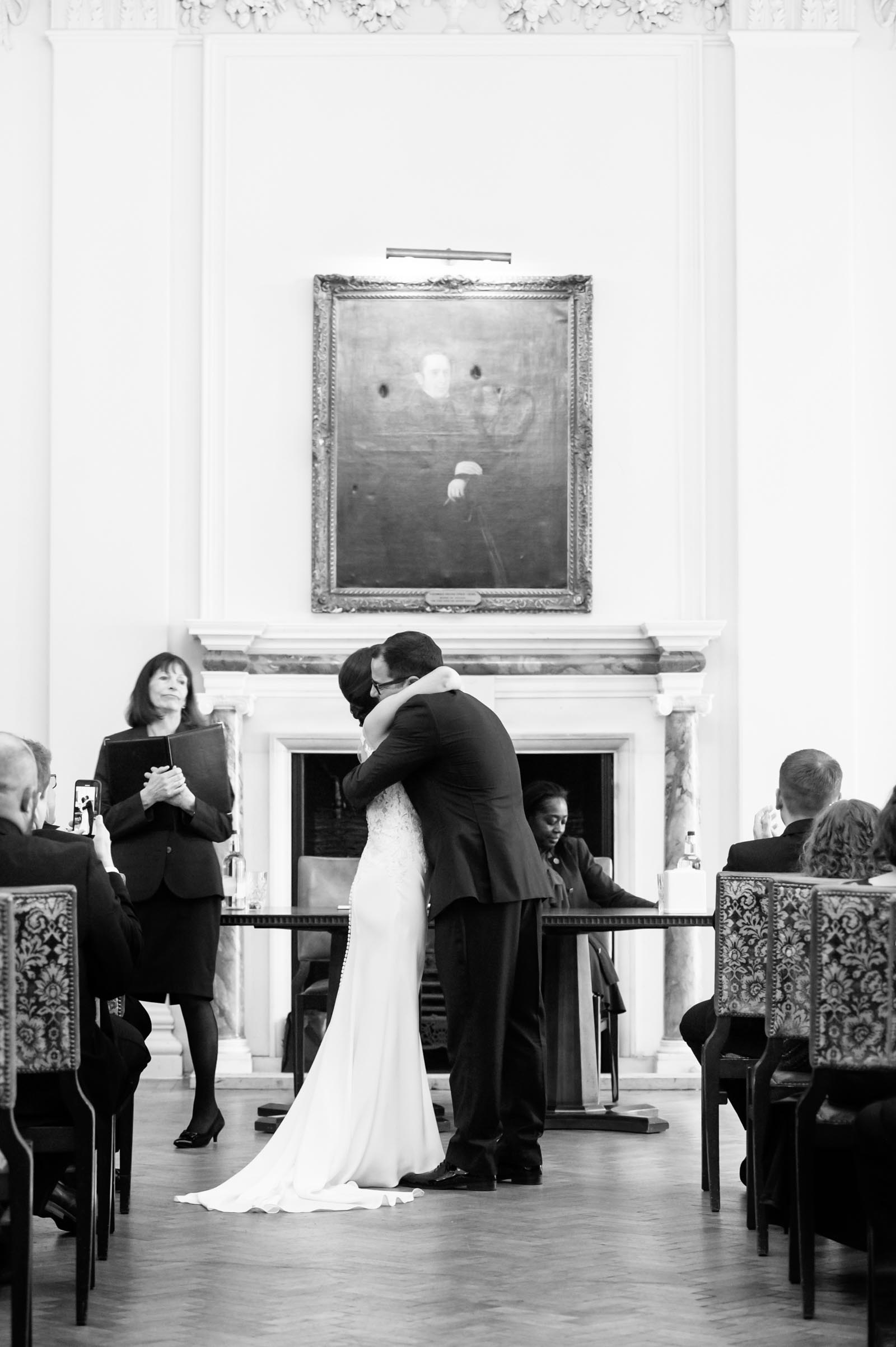 Couple embracing during wedding ceremony