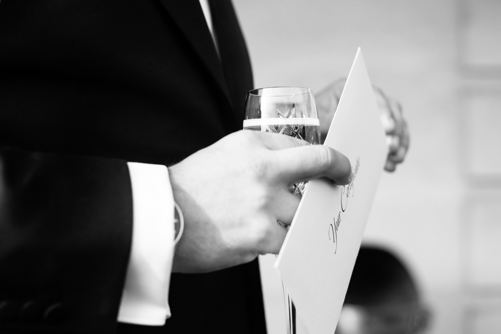 Close up of groom holding marriage certificate