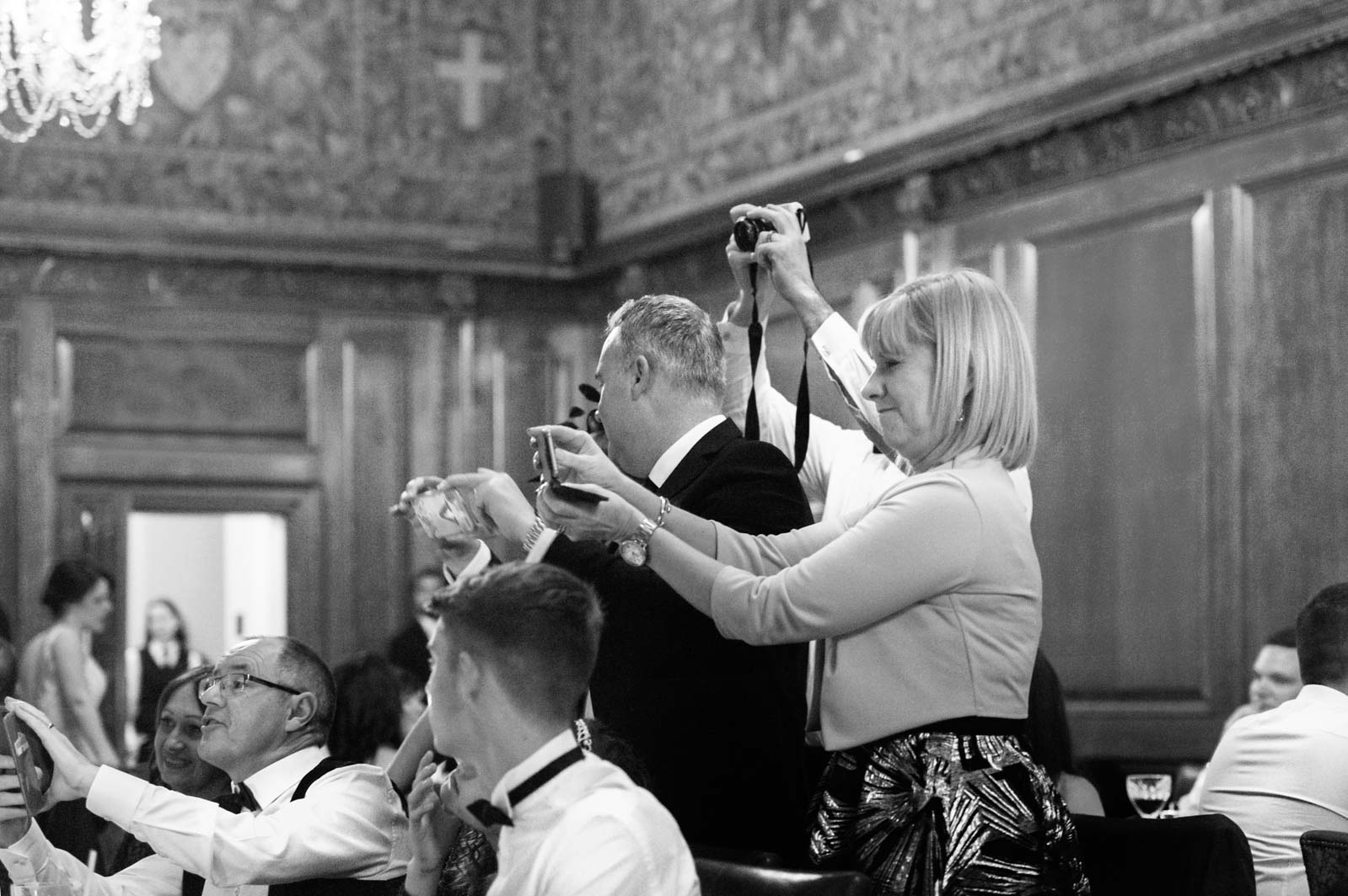 Crowd of wedding guests taking pictures