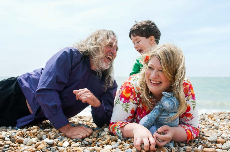 Family photo on Hastings beach by Sussex portrait photographer James Robertshaw