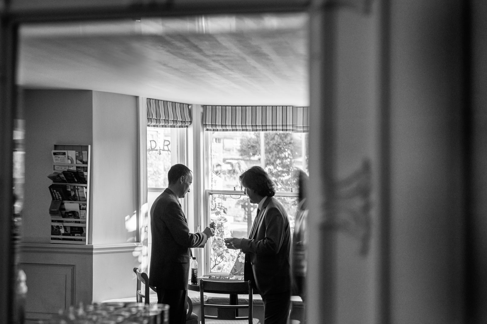 Groom and best man chatting