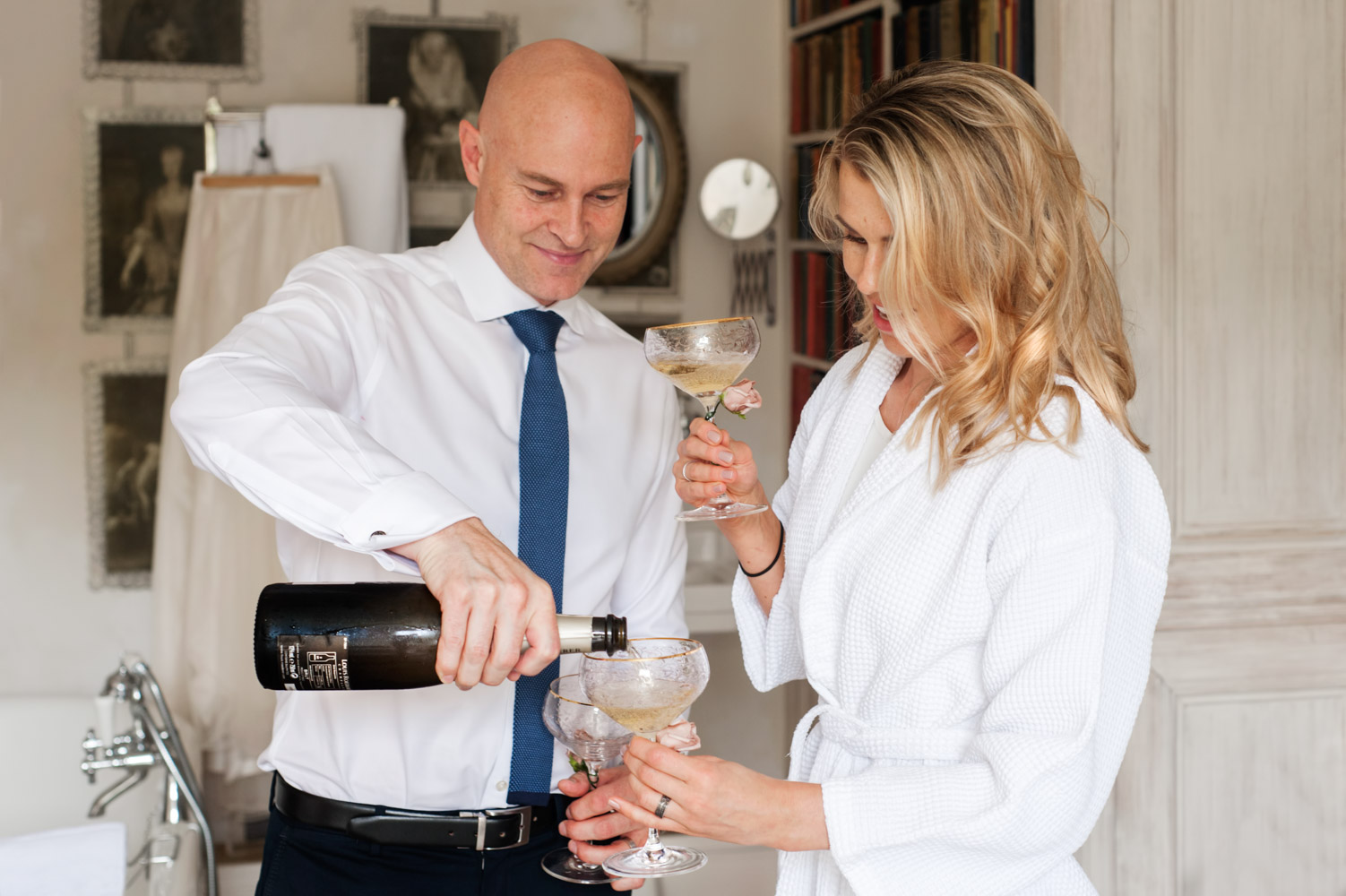 Groom pouring champange at the Old Rectory Hastings