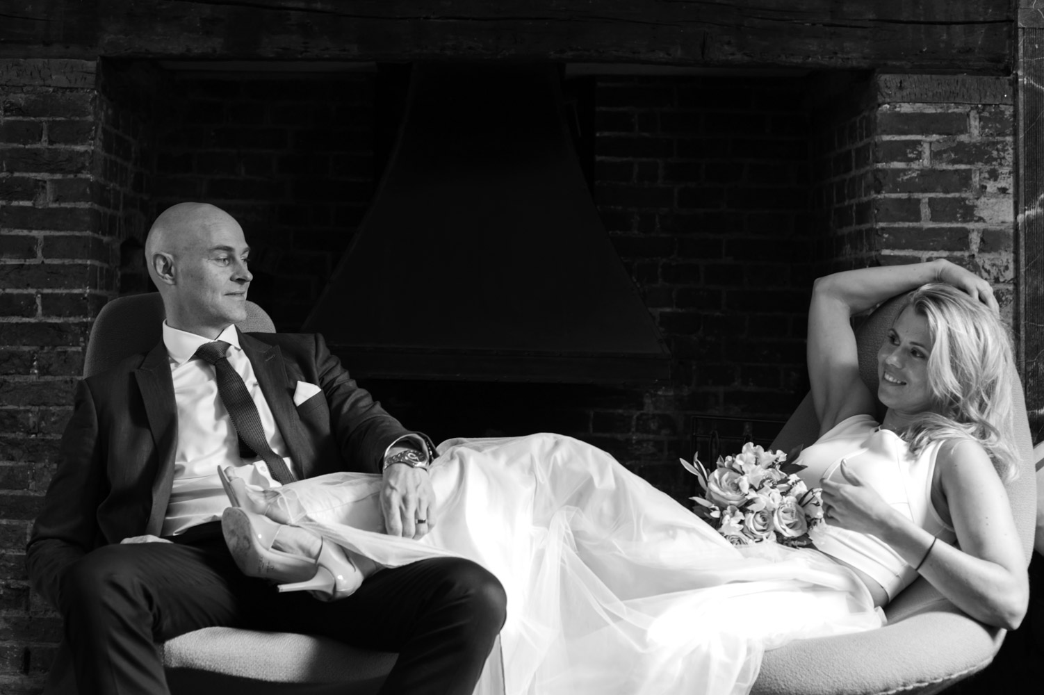 Bride and groom glance at the Old Rectory Hastings